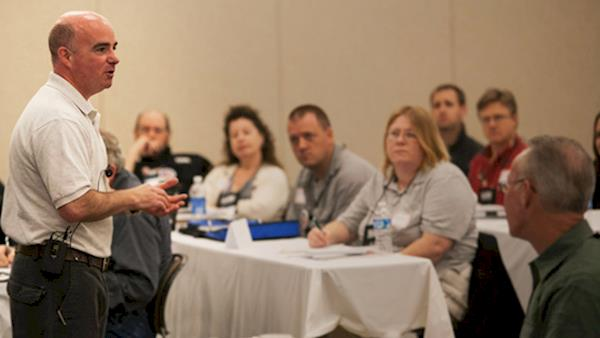 Refuse To Be A Victim® Instructor Speaking at a Seminar with Lots of People
