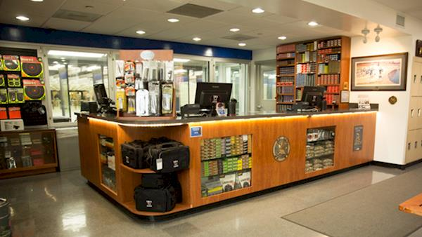 Check In Counter at the NRA Range Full of Accessories and Ammunition