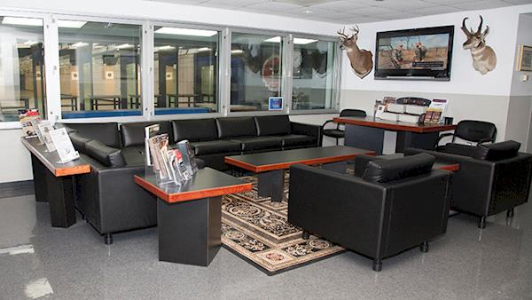 Comfortable Lounge with Leather Chairs and Windows Looking Out To the Indoor NRA Range