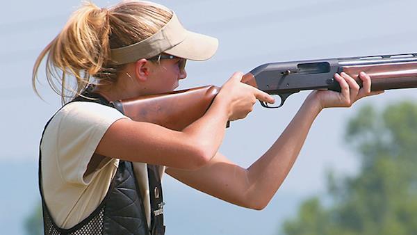 Women's Wilderness Escape Attendee Shooting a Shotgun