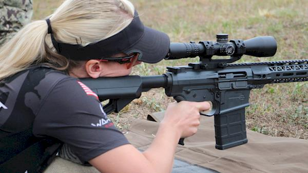Female Competitor Shooting a Scoped AR-15