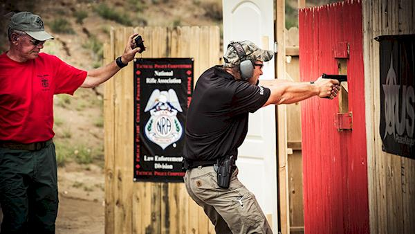 NRA Law Enforcement Competition shooting through an open door.