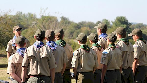 Group of Boy Scouts Listening to their Scout Leader