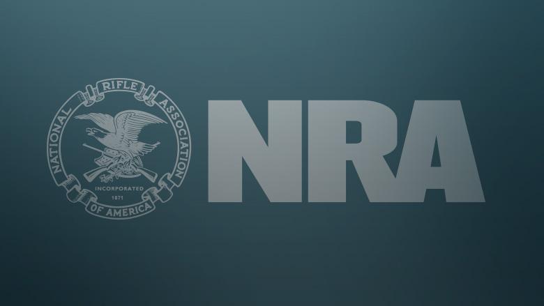 Light Grey NRA Logo on a Dark Blue Grey Background