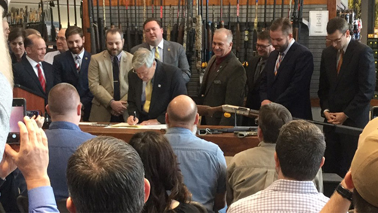 Hunting Legislation being signed at a ceremony.