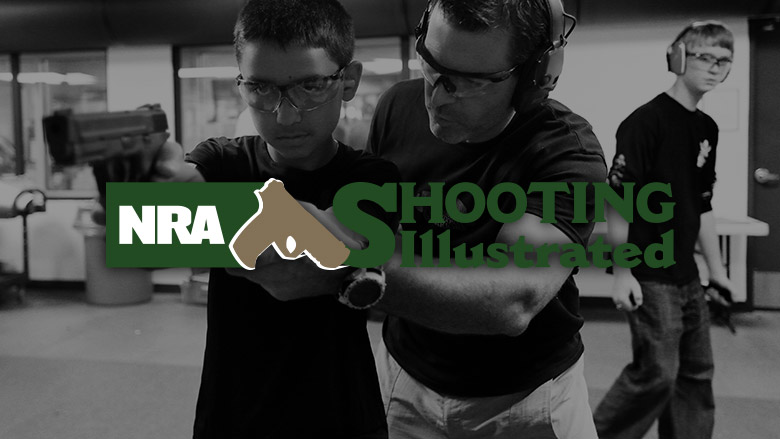 NRA Shooting Illustrated Logo on a Dark Background of a Gun Range