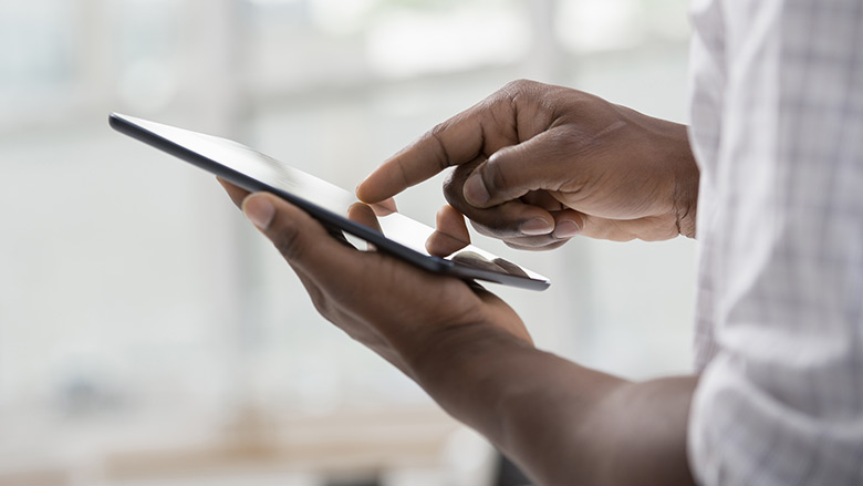 Man Using his Tablet to look up his Membership