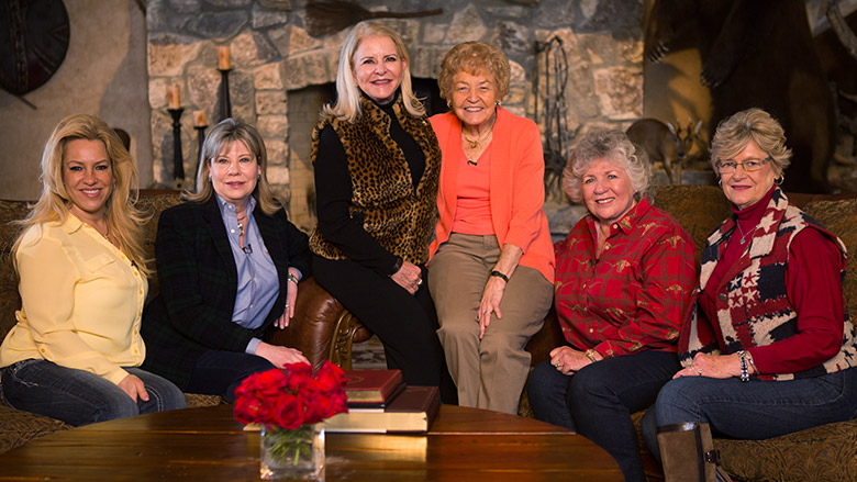 Distinguished NRA Women in Front of a Rock Fireplace