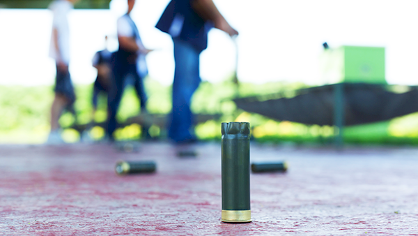 Spent Shotgun Shell On the Floor Of An Outdoor Range