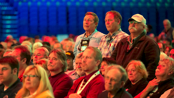 Three Proud NRA Members Being Recognized in a Large Audience
