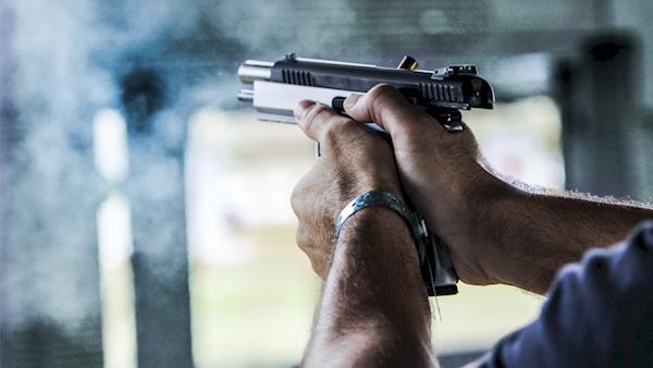 Pistol Mid-shot at an Outdoor Range
