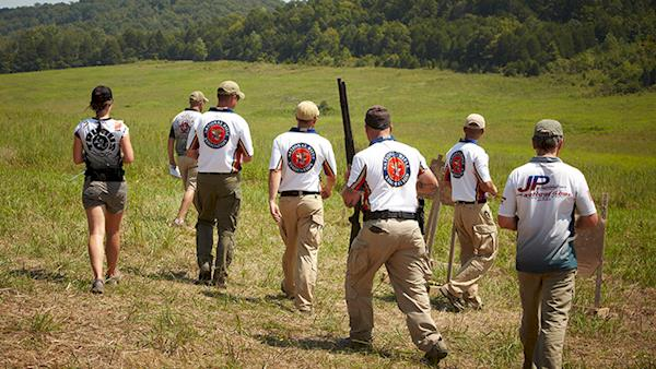 Group of NRA Shooters Approach Targets in a Field