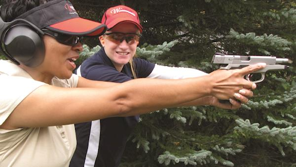Women On Target Instructor with a Student