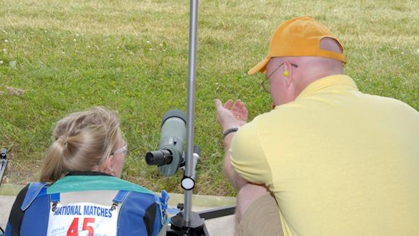 Young Female Competitor Discussing Her Shot with Her Coach