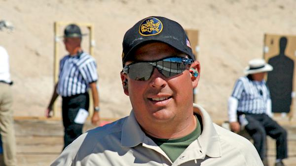 US Border Patrol Agent Participates in a Competition at an Outdoor Range