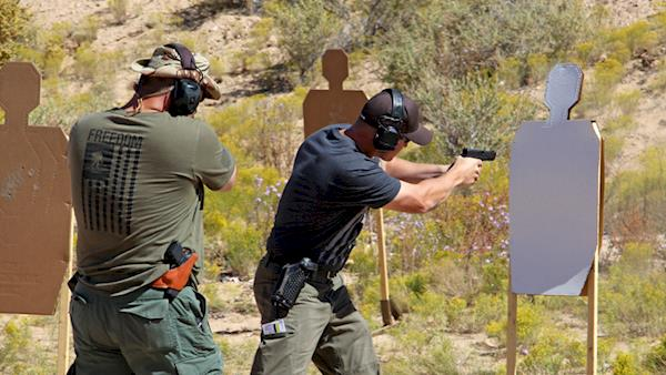 Tactical Police Competition Competitor Firing on a Silhouette Target on an Outdoor Range