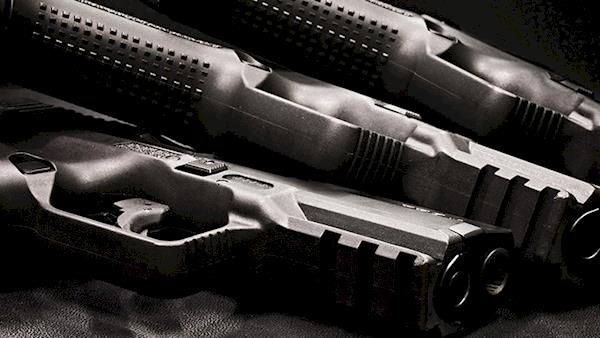 Artistic Photo of Three Firearms