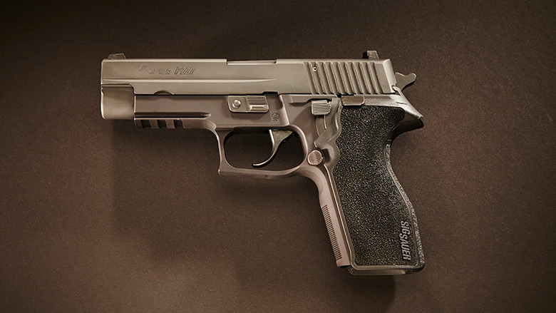 Pistol Laying on a Brown Background