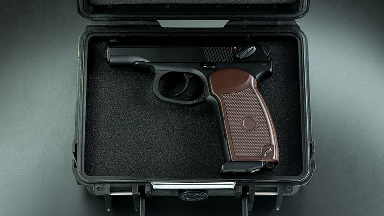 Opened Strong Box Reveals a Firearm