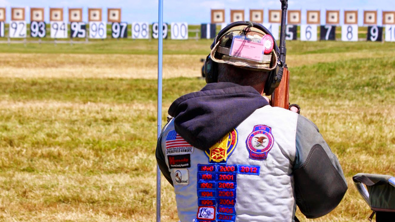 Competitive Shooter Looking Downrange at an Outdoor Gun Range