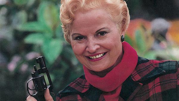 Jeanne E. Bray holding a revolver