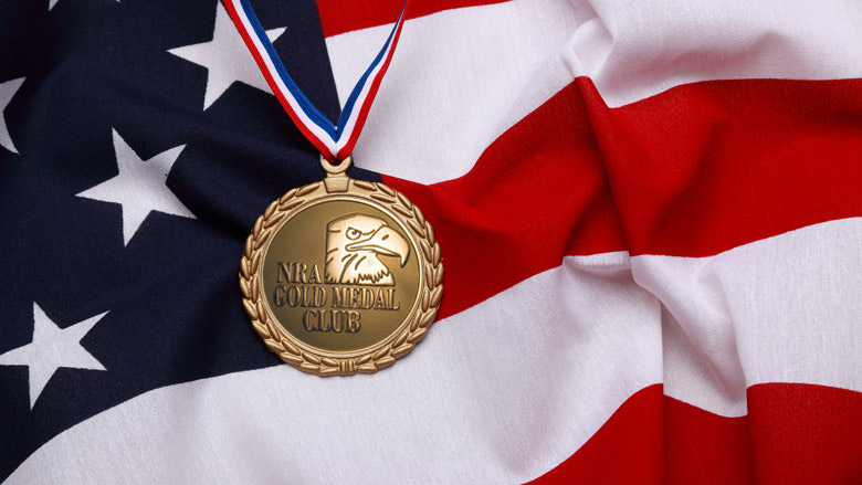 Gold Medal Award Draped Over the United States Flag