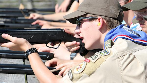 Firing Line of Boy Scouts Safely Shooting Rifles