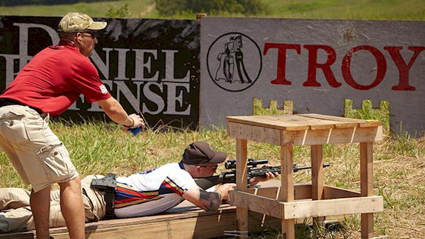 Marksman Laying Prone Shooting at an Outdoor Range