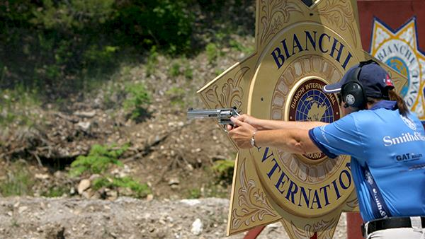 Bianchi Cup Competitor Shooting a Revolver in an Outdoor Range