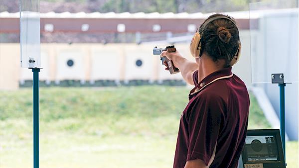 Collegiate Pistol Competitor at the Range