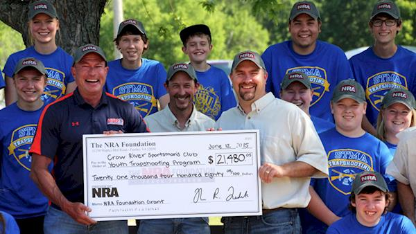 NRA Foundation awarding a club a huge check.
