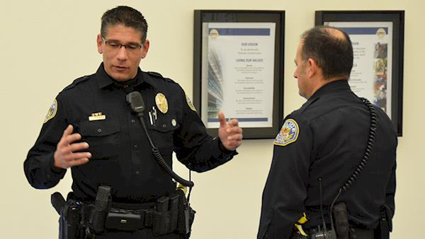 Two police officers discussing the importance of LEOSA benefits.