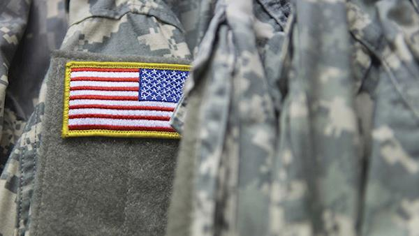 United States flag patch on the shoulder of military fatigues.