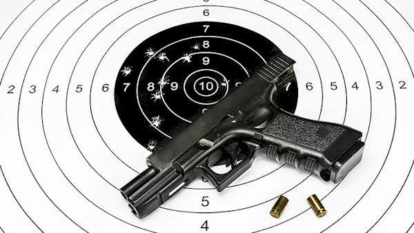 Pistol laying on a black and white target