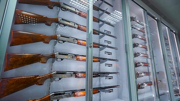 Display of Shotguns in a Glass Case